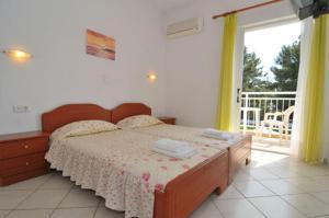 Ένα ή περισσότερα κρεβάτια σε δωμάτιο στο Villa Iris