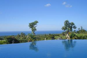 The swimming pool at or near Puri Mangga Sea View Resort and Spa