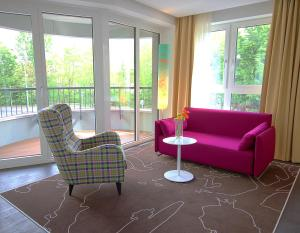 A seating area at Grimm's Hotel am Potsdamer Platz