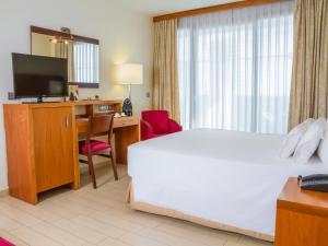 AR Diamante Beach Spa Hotelにあるベッド