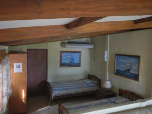 A bed or beds in a room at Punta Roca Surf Resort