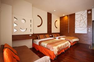 A bed or beds in a room at Itathao Vacation Hotel