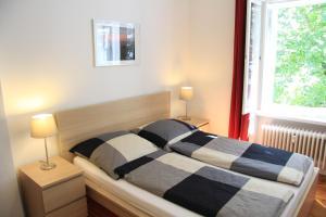 Ein Bett oder Betten in einem Zimmer der Unterkunft Nollendorf Apartments