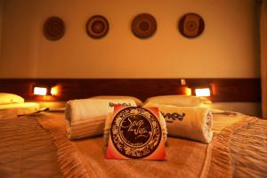 A bed or beds in a room at Ecoporan Hotel Charme Spa & Eventos