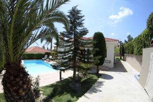 A view of the pool at Eve Pissouri Soultanina Villa or nearby