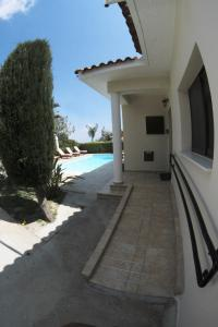 The swimming pool at or near Eve Pissouri Soultanina Villa