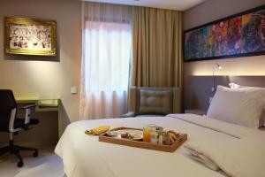 Кровать или кровати в номере SenS Hotel and Spa