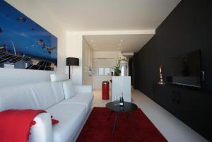 Een zitgedeelte bij Luxe Apartment Filine