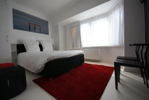 Een bed of bedden in een kamer bij Luxe Apartment Filine