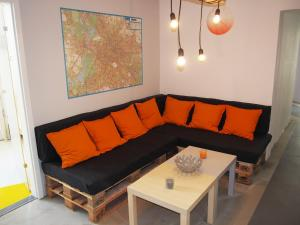 A seating area at Box61 Art Concept Flat