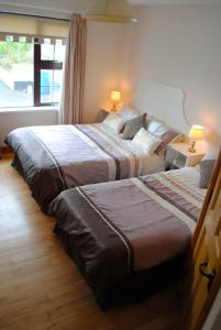 A bed or beds in a room at Milltown House