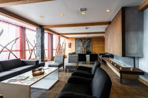 The lounge or bar area at Lagrange Vacances Le Roc Belle Face