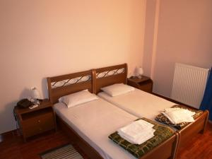 A bed or beds in a room at Hotel Pyrgos