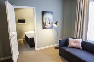 Een zitgedeelte bij Apartments Prinsengracht