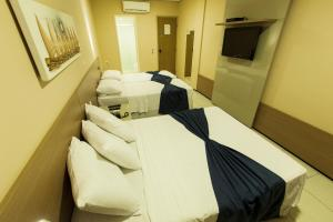 A bed or beds in a room at Fortaleza Mar Hotel
