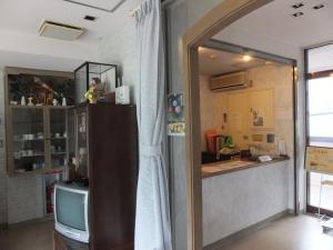 A kitchen or kitchenette at Sento Otani Hotel
