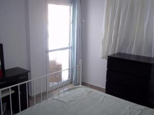 Postelja oz. postelje v sobi nastanitve Helen Apartment