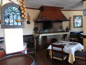 A restaurant or other place to eat at Rincón De Pepe