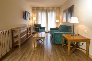 Ein Sitzbereich in der Unterkunft Aparthotel Shusski