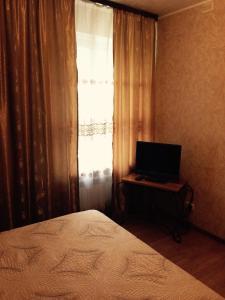 Кровать или кровати в номере Гостиница Классик