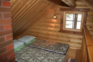 Vuode tai vuoteita majoituspaikassa Honkala Cottage