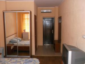Кровать или кровати в номере Parkovy Foros Hotel