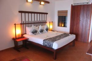 Кровать или кровати в номере The Long Beach Resort