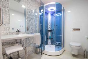 A bathroom at RuralSuite Hotel Apartamentos