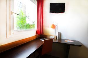 A television and/or entertainment center at Première Classe Paris Est Bobigny Drancy