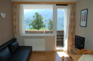 Ein Sitzbereich in der Unterkunft Appartement Alpensee