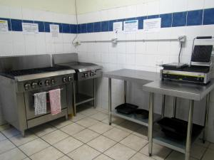 A kitchen or kitchenette at Manly Bunkhouse