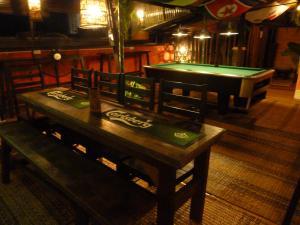 A pool table at Singgahsana Lodge