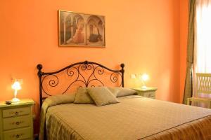Letto o letti in una camera di La Terrazza Di Montepulciano
