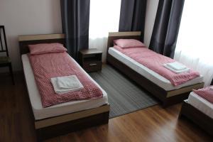 Кровать или кровати в номере Агроусадьба Бульбашик