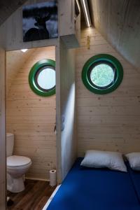 Ein Bett oder Betten in einem Zimmer der Unterkunft LeafMaxi