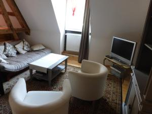 A seating area at Gîte Du Koenigstuhl