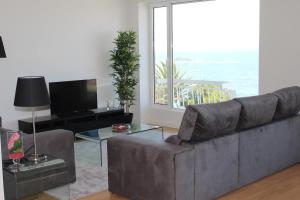 A seating area at OceanView Oporto Foz