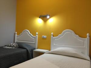 Um quarto em Guest House Sao Filipe