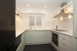 A kitchen or kitchenette at Bronte By Design - A Bondi Beach Holiday Home