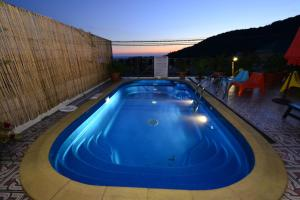 The swimming pool at or near European Guest House