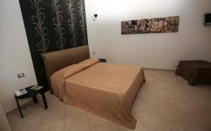 Кровать или кровати в номере Regalpetra Hotel
