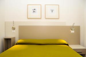 Postel nebo postele na pokoji v ubytování Hotel Da Mario