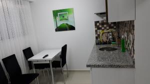 A kitchen or kitchenette at IMC Fatih Apartments