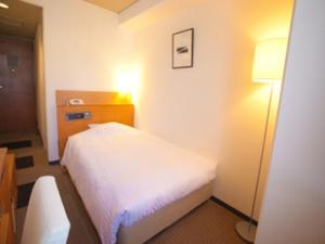 Tempat tidur dalam kamar di Hotel Lexton Kagoshima