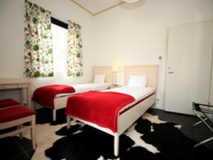 Säng eller sängar i ett rum på Wapnö Gårdshotell
