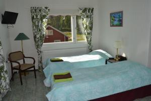Säng eller sängar i ett rum på Hostelli Kuninkaankartano
