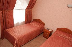 Кровать или кровати в номере Гостиница Колибри