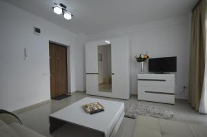 Un televizor și/sau centru de divertisment la Ambiance Apartment