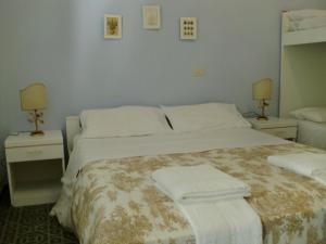 Letto o letti in una camera di Residence Marche - Residenza Ecologica