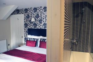 A bed or beds in a room at The Brantwood Hotel
